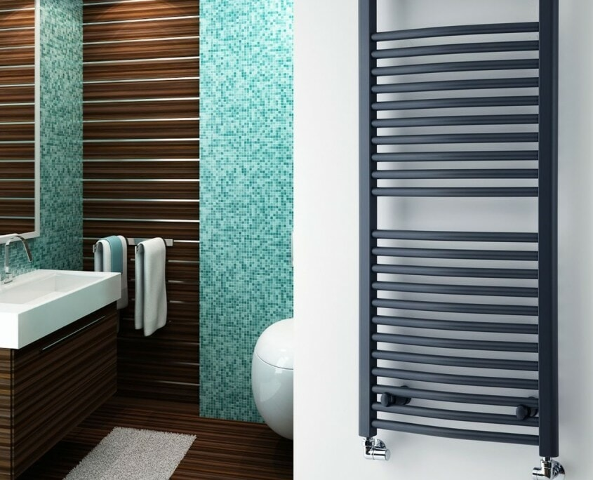 black vertical hydronic towel warmer on white wall