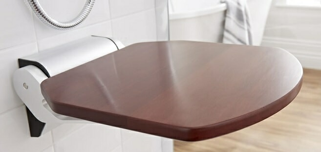 sapele shower seat on white bathroom tiles