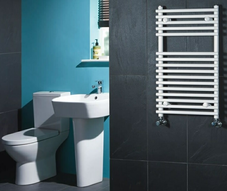 compact white heated towel warmer on black wall