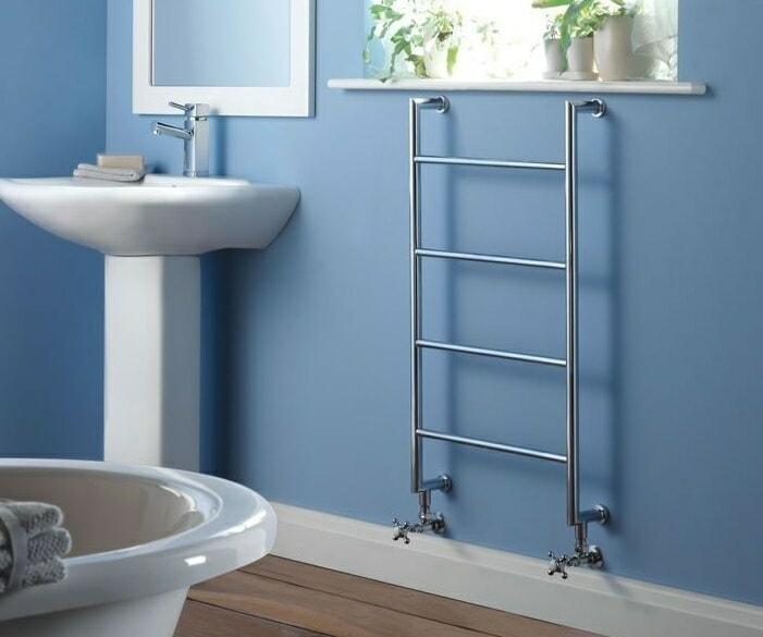 minimalist towel warmer on blue bathroom wall