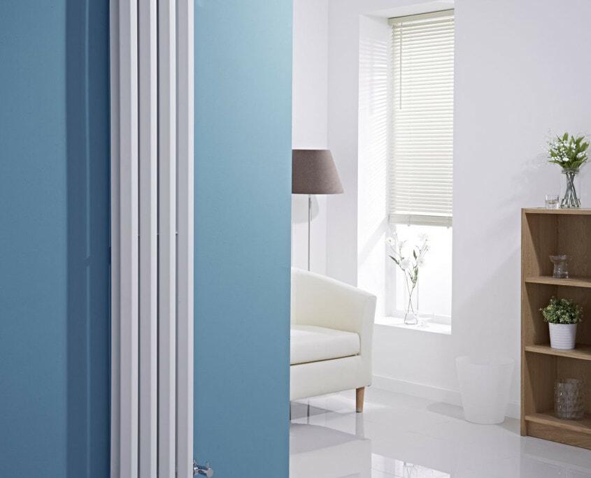 vertical white radiator blue wall