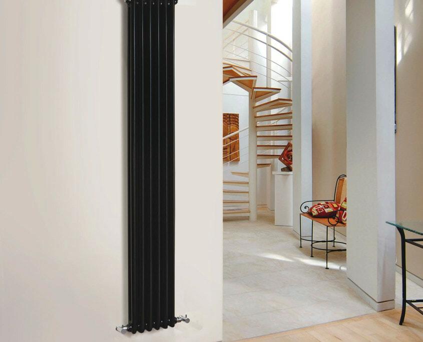 black cast iron radiator white wall
