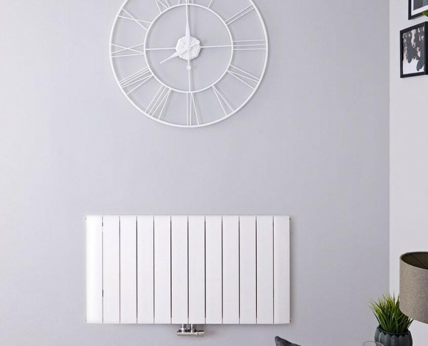 aurora white horizontal radiator below clock