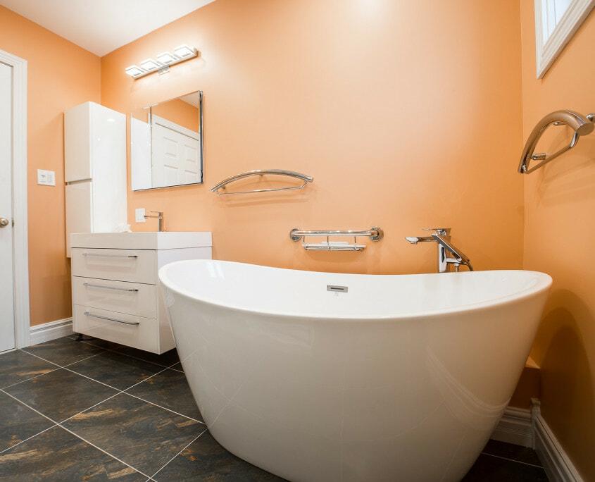 orange bathroom white freestanding tub
