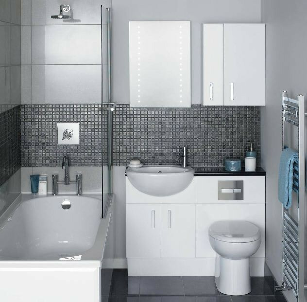 small modern bathroom with storage and towel warmer