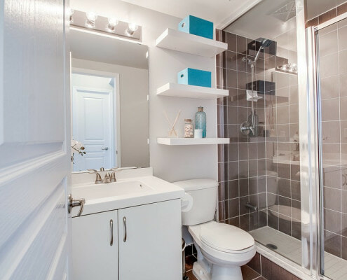 small bathroom with shelf stack