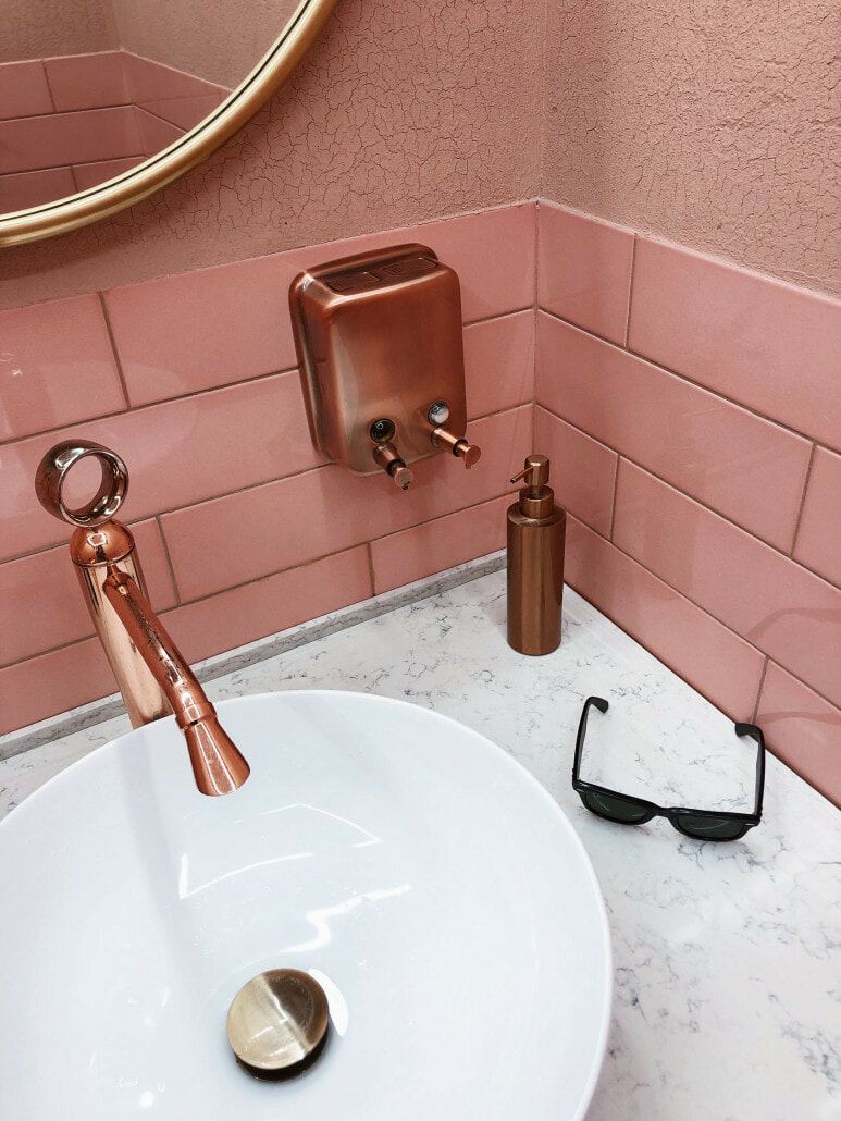 white sink copper fixtures